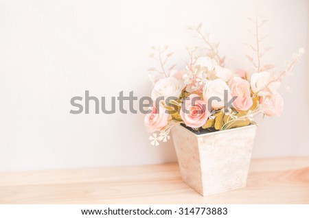 Pastel Coloured Artificial Pink Rose Wedding Bridal Bouquet in flower pot with soft vintage tone - stock photo