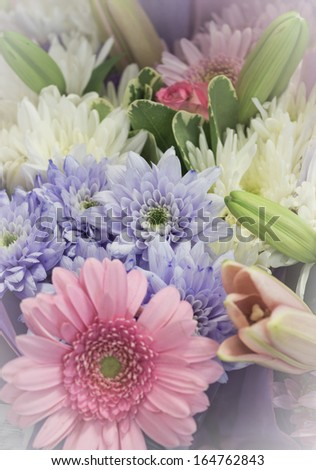 Pastel coloured flowers made into a bouquet - stock photo