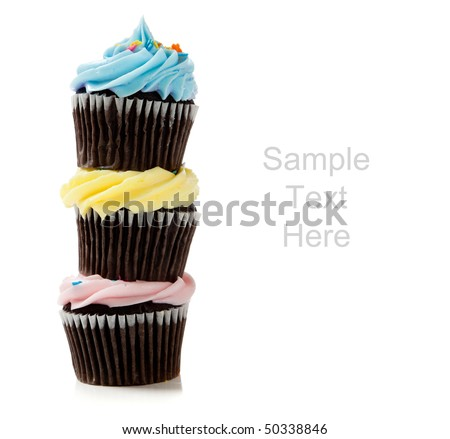 Pastel cupcakes including blue, pink and yellow on a white background with copy space - stock photo