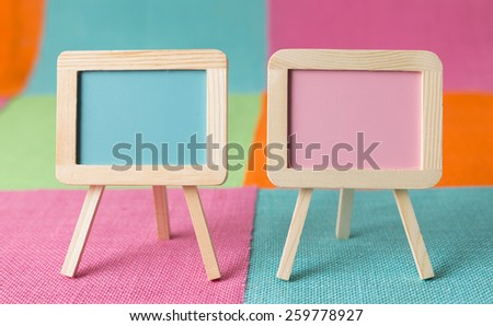 Pastel signs on pastel burlap - stock photo