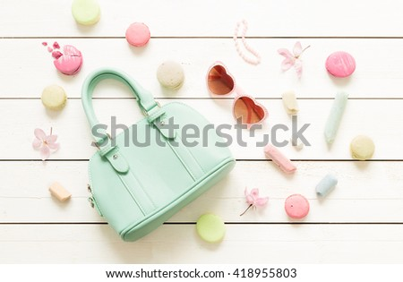 Pastel theme mood board with fashion accessories (bag, sunglasses) for girls. White rustic wooden background. Flat lay composition (from above, top view). - stock photo