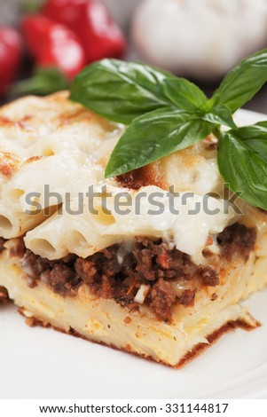 Pasticcio or pastitsio with ground beef and bechamel sauce, italian baked pasta - stock photo