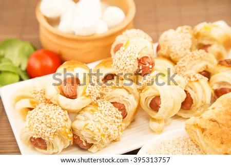 Pastry snack with mini dogs and  mozzarella - stock photo