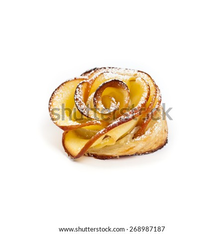 Pastry with apple shaped roses on white background. Selective focus. - stock photo