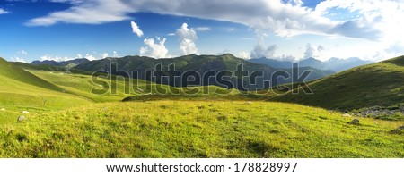 Pasture in mountain valley. Agriculture landscape - stock photo
