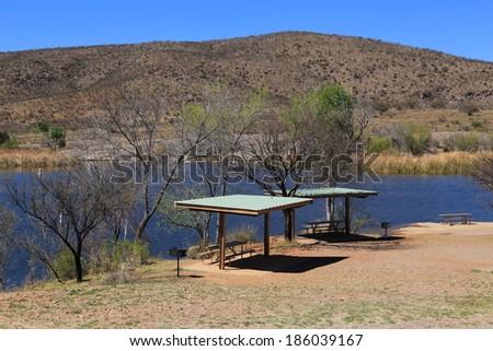 Patagonia Lake State Park in Arizona features picnic ramadas and pristine blue water. - stock photo