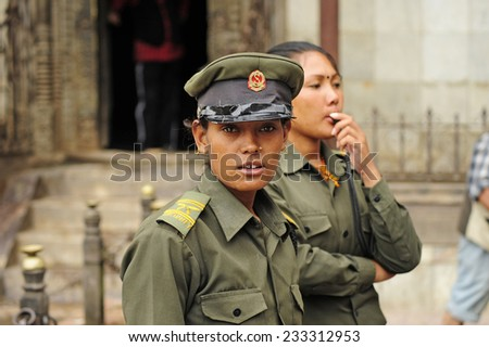 Patan, Nepal. August, 22, 2010. Nepalese female cop in Patan - stock photo