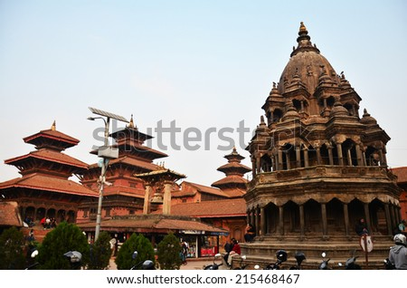 PATAN, NEPAL - NOVEMBER 1 : Traveler and Nepalese people come to Patan Durbar Square for travel and pray on November 1, 2013 in Patan Nepal  - stock photo