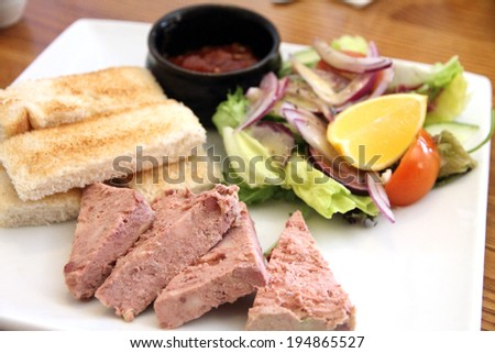 Pate campagne with toast and salad UK - stock photo