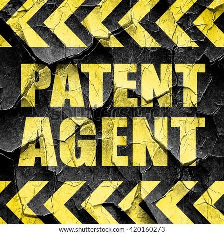 patent agent, black and yellow rough hazard stripes - stock photo