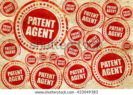 patent agent, red stamp on a grunge paper texture - stock photo