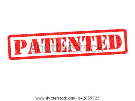 PATENTED Rubber Stamp over a white background. - stock photo