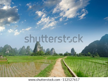 Path across the fields in guilin,china - stock photo