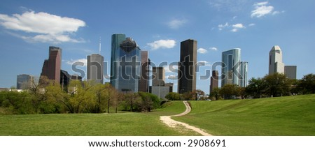 Path in park leading to city skyline - stock photo