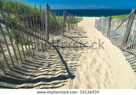 Path in the sand heading to the beach - stock photo