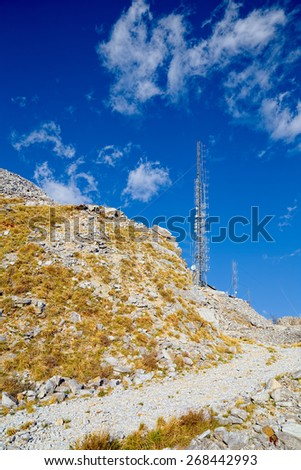 Path of a marble quarry that leads to a central communication radio installed on the summit - stock photo