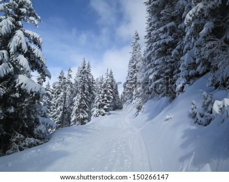Path through the snow, Verbier, Switzerland - stock photo