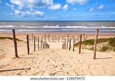 path to sandy beach by North sea in Zandvoort aan Zee - stock photo