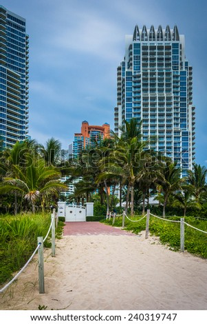 Path to the beach and highrises in South Beach, Miami, Florida. - stock photo