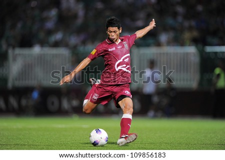 PATHUM THANI,THAILAND-APRIL 7:Pokkhao Anan Insee Police UTD. hit the ball during Thai Premier League between Bangkok Glass FC.and Insee Police UTD.at Leo Stadium on April7,2012 in PathumThani,Thailand - stock photo