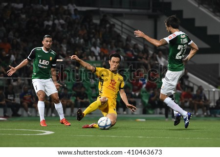PATHUM THANI,THAILAND-MAR 6:Ahn Jae-hoonb of Osotspa M-150 in action during Thai Premier League 2016 between Bangkok Glass FC.and Osotspa M-150 at Leo Stadium on March 6,2016 in PathumThani,Thailand - stock photo