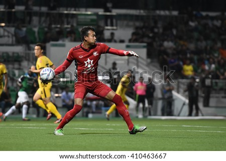 PATHUM THANI,THAILAND-MAR 6:Chatchai Budprom of Osotspa M-150 in action during Thai Premier League 2016 between Bangkok Glass FC.and Osotspa M-150at Leo Stadium on March 6,2016 in PathumThani,Thailand - stock photo