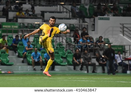 PATHUM THANI,THAILAND-MAR 6:Pollawat Pinkong of Osotspa M-150 in action during Thai Premier League 2016 between Bangkok Glass FCand Osotspa M-150 at Leo Stadium on March 6,2016 in PathumThani,Thailand - stock photo