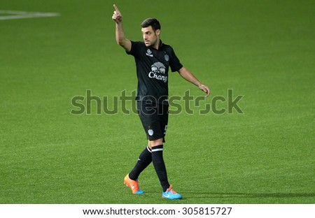 PATHUMTHANI, THAILAND- AUG12: Andres Tunez #5 of BuriramUtd in action during Thai Premier League 2015 between BGFC and BuriramUtd at Leo Stadium on August 12, 2015 in Thailand. - stock photo