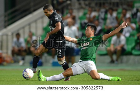 PATHUMTHANI, THAILAND- AUG12: Gilberto Macena(L) of BuriramUtd in action during Thai Premier League 2015 between BGFC and BuriramUtd at Leo Stadium on August 12, 2015 in Thailand. - stock photo