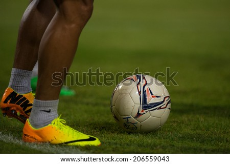 PATHUMTHANI THAILAND-Jul19:Soccer shoes or football during the Thai Premier League between Police United and Sisaket FC at Thammasat Stadium on July 19,2014,Thailand - stock photo