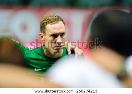 PATHUMTHANI,THAILAND, MARCH 2015 :Matthew Smith(G) of BGFC in action during geam Thai premier League 2015 between Bangkok Glass FC and Bangkok UTD at LeoStadium on MARCH 11, 2015 in Thailand - stock photo