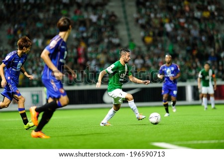 PATHUMTHANI,THAILAND May 31 : Flavien Michelini(7)of BGFC in action during geam Thai premier League 2014 between Bangkok Glass FC and Ratchaburi FC at LeoStadium on May 31, 2014 in Thailand - stock photo