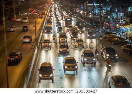 Pathumthani,Thailand-November 13,2014 : Night busy traffic in motion blur car at Ransit road in Pathumthani , Thailand. - stock photo