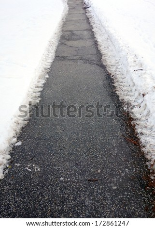 Pathway cleared from snow - stock photo