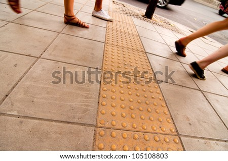 Pathway in Thailand with concrete bumps for blind pedestrians - stock photo