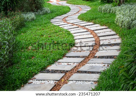Pathway stones on green grass. - stock photo