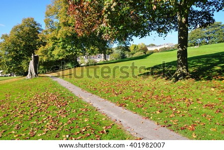 Pathway through a Beautiful Leafy Park - stock photo