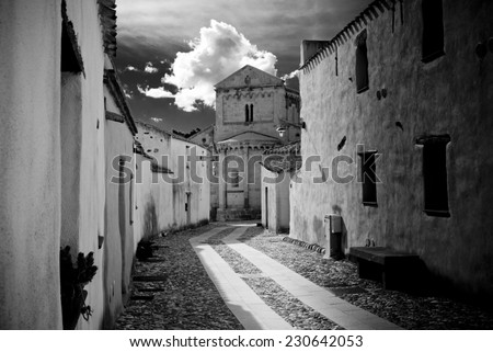Pathway to cathedral/ the center of a village in black and white - stock photo