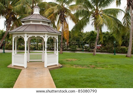 pathway to grgeous white gazebo after a tropical storm (outdoor setting) - stock photo