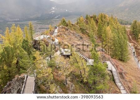 pathway to the top of kanas lake scenic spot , xinjiang. - stock photo