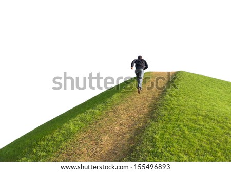Pathway up the hill against the sky. Man ran to the top. Symbol development or career growth. - stock photo