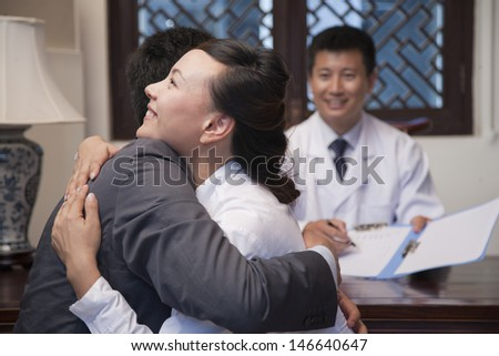 Patient and Spouse Hug at the Good News - stock photo