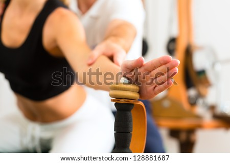Patient at the physiotherapy making physical exercises - stock photo