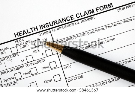 Patient fills in the medical claim form - stock photo