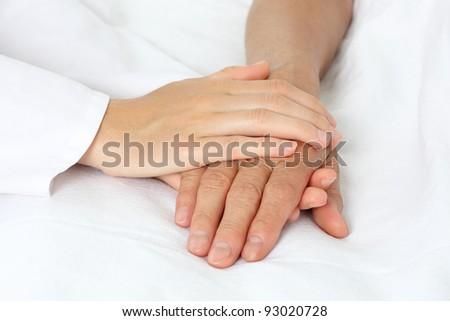 Patient hand in bed - stock photo