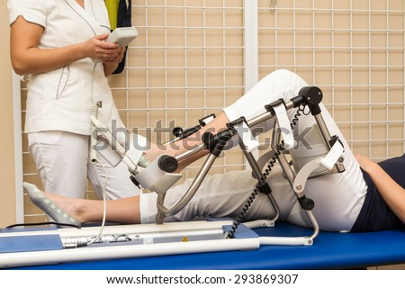 Patient having knee rehabilitation in medical office - stock photo