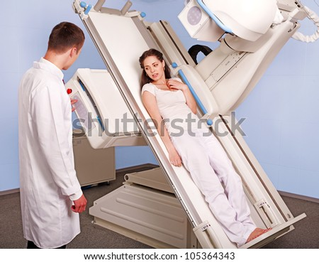 Patient  in x-ray room looking at doctor. Medicine. - stock photo
