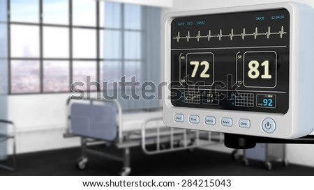 Patient monitor device closeup in hospital room with depth of field - stock photo