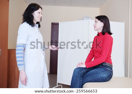 Patient on the examination by a doctor - stock photo