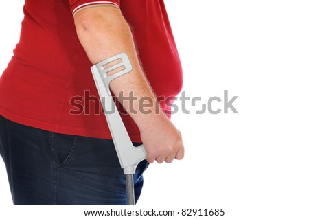 Patient with crutches in front of a white background - stock photo